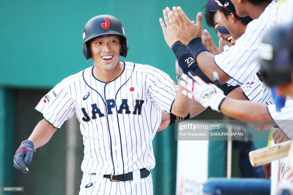 Shuhei Fukuda of Japan celerates after scoring in the bottom half of the eight inning during the 28th Asian Baseball Championship Super Round match between Japan and South Korea at Hsing-Chuang Stadium on October 6, 2017 in New Taipei City, Taiwan.