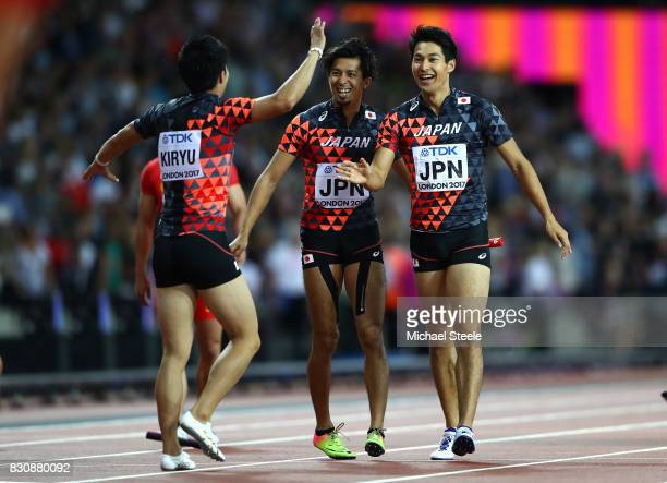 Shuhei Tada Shota Iizuka and Yoshihide Kiryu of Japan celebrate winning bronze in the Men's 4x100 Relay final during day nine of the 16th IAAF World...