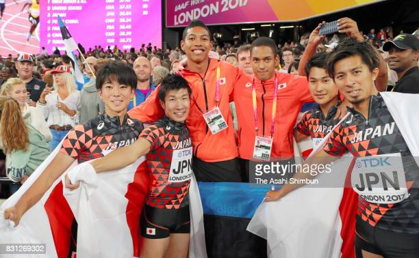 Shuhei Tada Shota Iizuka Yoshihide Kiryu Abdul Hakim Sani Brown Aska Cambridge and Kenji Fujimitsu of Japan celebrate winning bronze in the Men's...