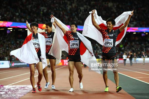 Shuhei Tada Shota Iizuka Yoshihide Kiryu and Kenji Fujimitsu of Japan celebrate winning bronze in the Men's 4x100 Relay final during day nine of the...