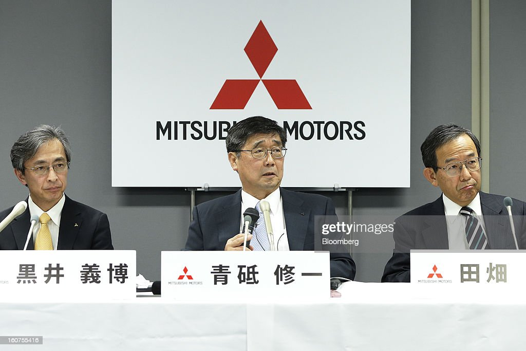 Shuichi Aoto, managing director of Mitsubishi Motors Corp., center, speaks as Yoshihiro Kuroi, senior executive officer, left, and Yutaka Tabata, senior executive officer, listen during a news conference in Tokyo, Japan, on Tuesday, Feb. 5, 2013. Shares in Mitsubishi Motors dropped after the company reduced its operating profit forecast. Photographer: Kiyoshi Ota/Bloomberg via Getty Images