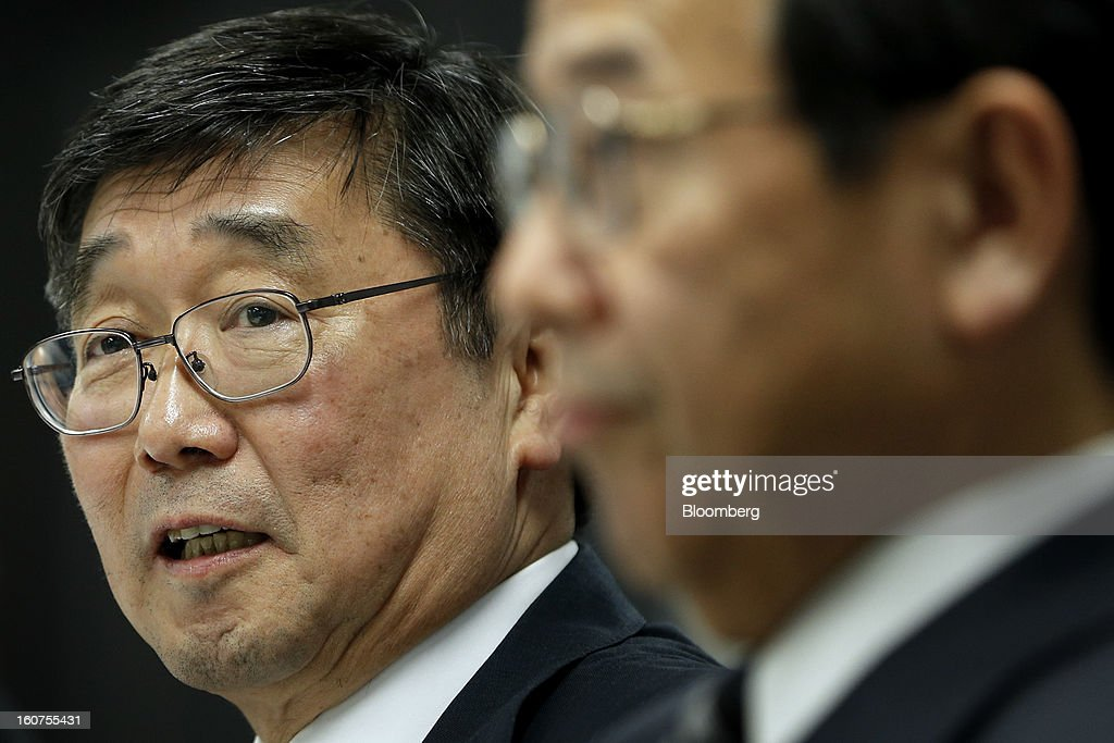 Shuichi Aoto, managing director of Mitsubishi Motors Corp., left, speaks as Yutaka Tabata, senior executive officer, listens during a news conference in Tokyo, Japan, on Tuesday, Feb. 5, 2013. Shares in Mitsubishi Motors dropped after the company reduced its operating profit forecast. Photographer: Kiyoshi Ota/Bloomberg via Getty Images