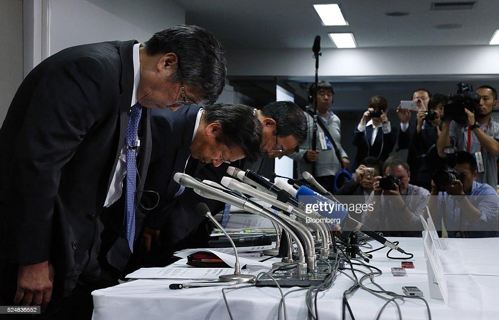 Shuichi Aoto managing director of Mitsubishi Motors Corp left Tetsuro Aikawa president and chief operating officer of Mitsubishi Motors Corp center...
