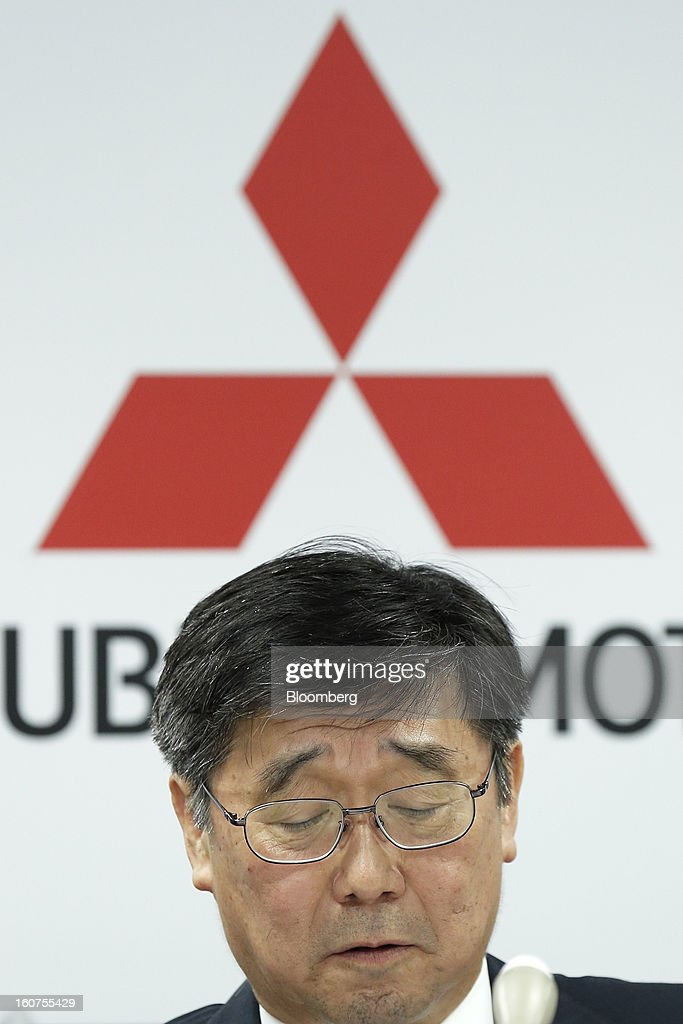 Shuichi Aoto, managing director of Mitsubishi Motors Corp., reacts during a news conference in Tokyo, Japan, on Tuesday, Feb. 5, 2013. Shares in Mitsubishi Motors dropped after the company reduced its operating profit forecast. Photographer: Kiyoshi Ota/Bloomberg via Getty Images