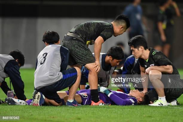 Shuichi Gonda of Sagan Tosu receives medical treatment before stretched off during the JLeague J1 match between Vegalta Sendai and Sagan Tosu at...