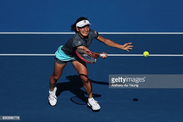 Shuko Aoyama of Japan plays a volley with Makoto Ninomiya of Japan in their doubles match against Kirsten Flipkens of Belgium and Jelena Ostapenko of...