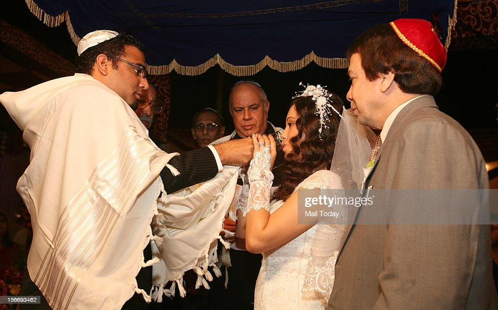 Shulamith Ezekiel Malekar with husband Sharon drinks wine from the same glass as a part of ritual the Jewish bride and the groom get married in the Bene Israel tradition Delhi hosts first Indian Jewish wedding in 50 years.
