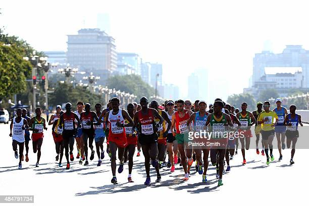 Shumi Dechasa of Bahrain Mark Korir of Kenya Yemane Tsegay of Ethiopia lead the pack at the start of the Men's Marathon during day one of the 15th...