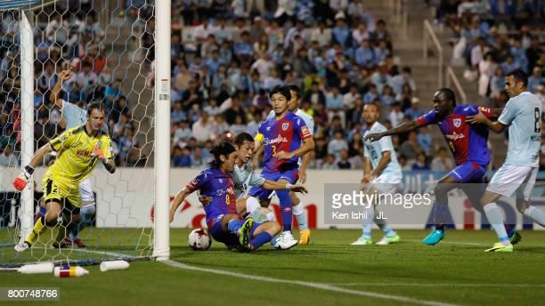 Shun Morishita of Jubilo Iwata and Yojiro Takahagi of FC Tokyo compete for the ball during the JLeague J1 match between Jubilo Iwata and FC Tokyo at...