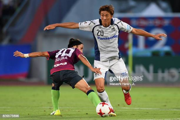 Shun Nagasawa of Gamba Osaka and Shohei Ogura of Ventforet Kofu compete for the ball during the JLeague J1 match between Ventforet Kofu and Gamba...
