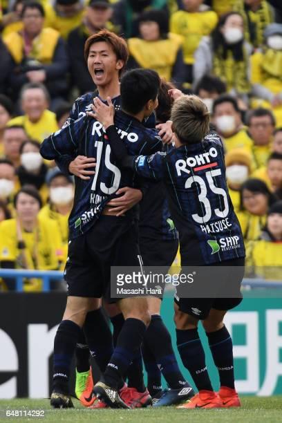 Shun Nagasawa of Gamba Osaka celebrates scoring the opening goal with his team mates during the JLeague J1 match between Kashiwa Reysol and Gamba...