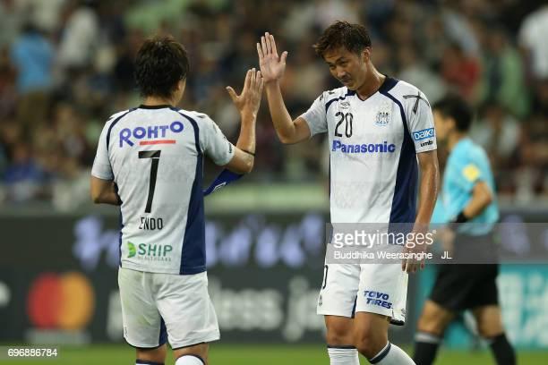 Shun Nagasawa of Gamba Osaka celebrates with Yasuhito Endo after their 10 victory in the JLeague J1 match between Vissel Kobe and Gamba Osaka at...
