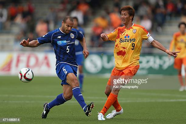 Shun Nagasawa of Shimizu SPulse and Alceu Rodrigues Simoni Filho of Montedio Yamagata compete for the ball during the JLeague match between Shimizu...