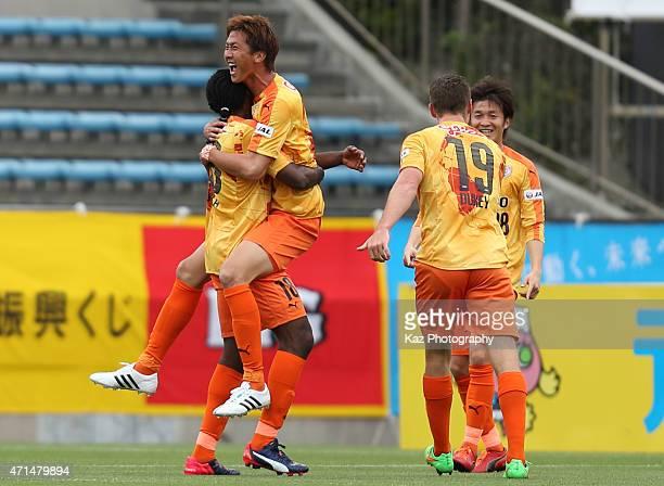 Shun Nagasawa of Shimizu SPulse celebrates scoring his team's second goal with his team mates during the JLeague match between Shimizu SPulse and...