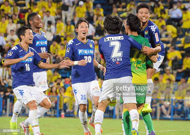 Shun Takagi of JEF United Chiba is congratulated by his teammates after the penalty shootout win in the Emperor's Cup third round match between JEF...