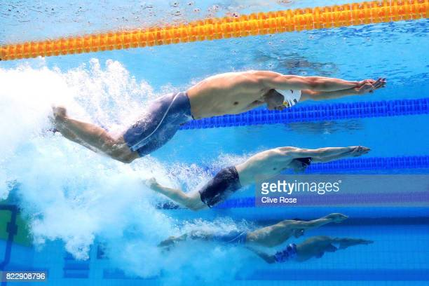 Shun Wang of China Max Litchfield of Great Britain and Bradlee Ashby of New Zealand competes during the Men's 200m Individual Medley Heats on day...