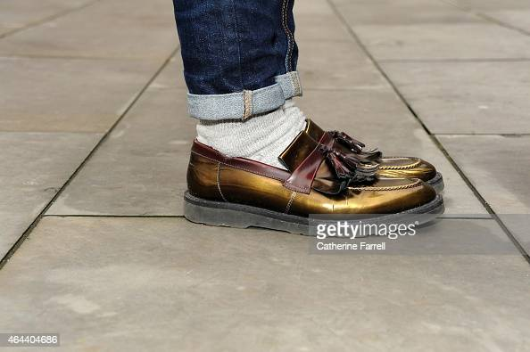 Shunichiro Naga wearing Paul Smith vintage shoes during London Fashion Week Fall/Winter 2015/16 on February 20 2015 in London England