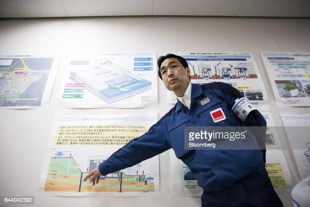 Shunji Uchida plant chief at Tokyo Electric Power Co's Fukushima Daiichi nuclear power plant makes a presentation to visitors in Okuma Fukushima...