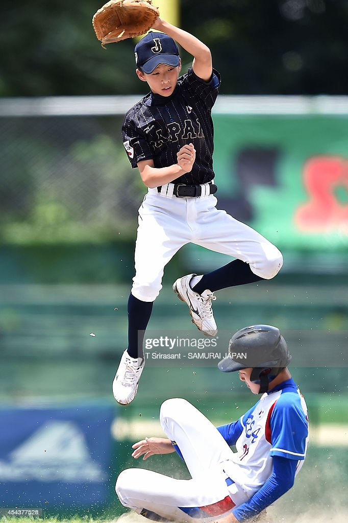 Shunnoske Araki #1 of Japan jumps during the 8th 12U Asian Baseball Championship game between South Korea and Japan at Rizal Memorial Baseball Stadium on August 30, 2014 in Manila, Philippines.