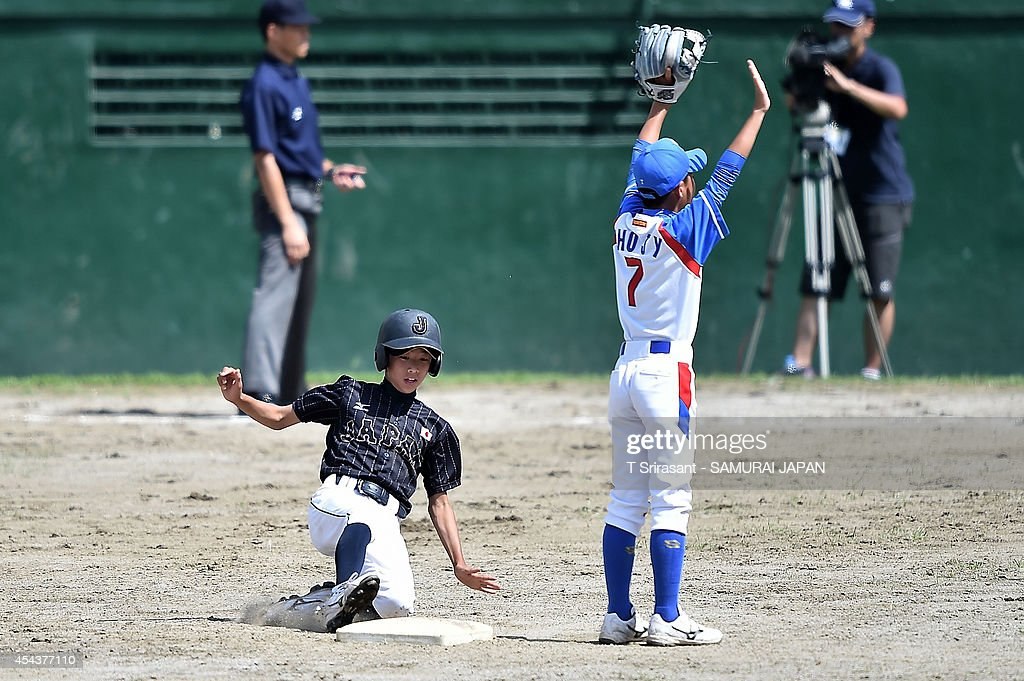 Shunnoske Araki #1 of Japan slides to base during the 8th 12U Asian Baseball Championship game between South Korea and Japan at Rizal Memorial Baseball Stadium on August 30, 2014 in Manila, Philippines.