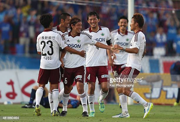 Shunsuke Iwanuma of Matsumoto Yamaga celebrates scoring his team's first goal with his team mates during the JLeague match between Ventforet Kofu and...