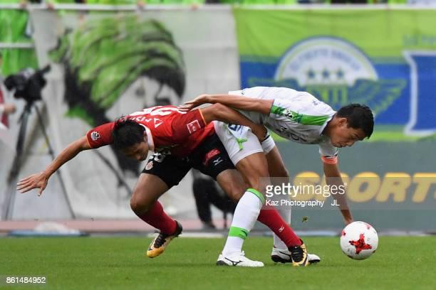 Shunsuke Kikuchi of Shonan Bellmare and Keiji Tamada of Nagoya Grampus compete for the ball during the JLeague J2 match between Nagoya Grampus and...