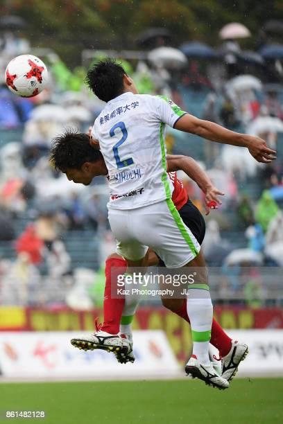 Shunsuke Kikuchi of Shonan Bellmare and Taishi Taguchi of Nagoya Grampus compete for the ball during the JLeague J2 match between Nagoya Grampus and...