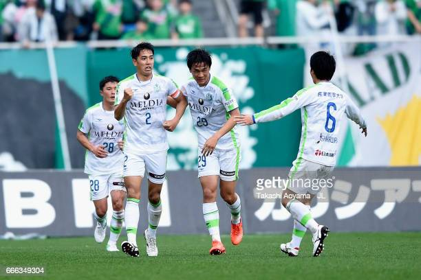 Shunsuke Kikuchi of Shonan Bellmare celebrates scoring his side's first goal with his team mates during the JLeague J2 match between Tokyo Verdy and...