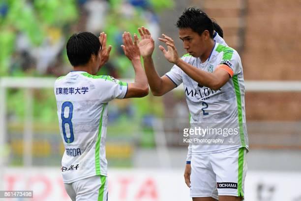 Shunsuke Kikuchi of Shonan Bellmare celebrates scoring his side's first goal with his team mate Naoki Yamada during the JLeague J2 match between...