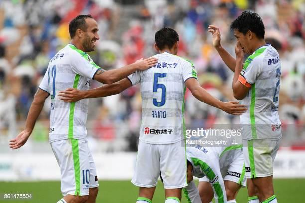 Shunsuke Kikuchi of Shonan Bellmare celebrates scoring his side's second goal with his team mates during the JLeague J2 match between Nagoya Grampus...