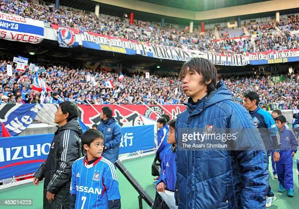 Shunsuke Nakamura and Yokohama FMarinos players walk around the pitch after the JLeague match between Yokohama FMarinos and Albirex Niigata at Nissan...