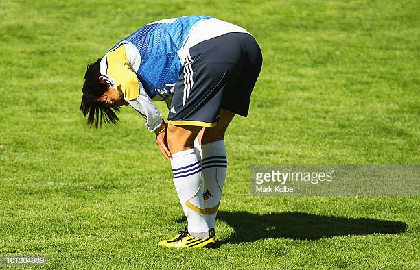 Shunsuke Nakamura holds his leg after contact in a tackle during a practice match between Japan XI and Sion XI as part of Japan training on May 31...