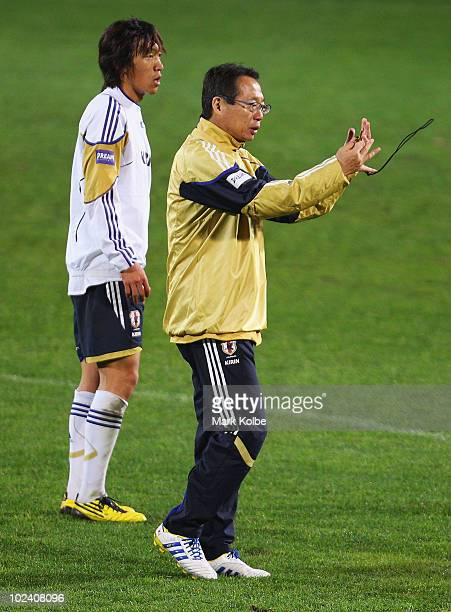 Shunsuke Nakamura looks on as Japan coach Takeshi Okada gives instructions at a Japan training session during the FIFA 2010 World Cup at Outeniqua...