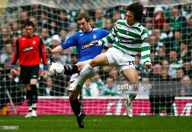 Shunsuke Nakamura of Celtic is tackled by Kevin Thomson of Rangers during the Scottish Premier League match between Celtic and Rangers at Celtic Park...