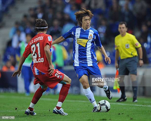 Shunsuke Nakamura of Espanyol is challenged by David Cortes of Getafe during the Copa del Rey 2nd Leg match between Espanyol and Getafe at CornellaEl...