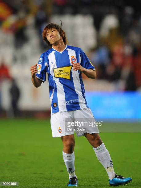 Shunsuke Nakamura of Espanyol reacts after his free kick went wide of goal during the La Liga match between Espanyol and Sporting Gijon at El Molinon...