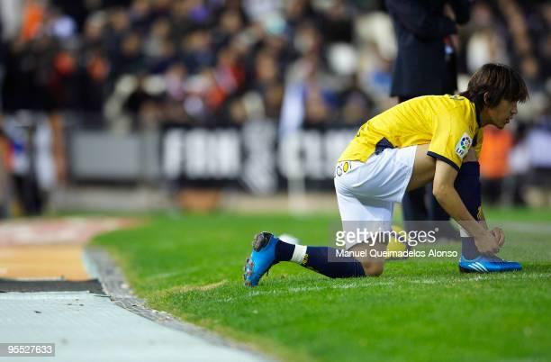 Shunsuke Nakamura of Espanyol warms up on the sideline during the La Liga match between Valencia and Espanyol at Estadio Mestalla on January 2 2010...