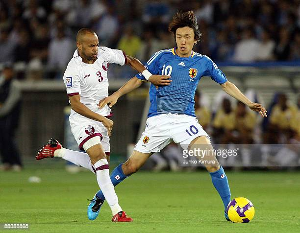 Shunsuke Nakamura of Japan and Hamed Shami Zaher of Qatar compete for the ball during the 2010 FIFA World Cup qualifier match between Japan and Qatar...