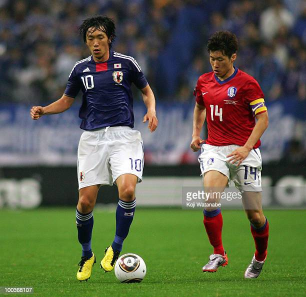 Shunsuke Nakamura of Japan and Ji SungPark of South Korea compete for the ball during the international friendly match between Japan and South Korea...