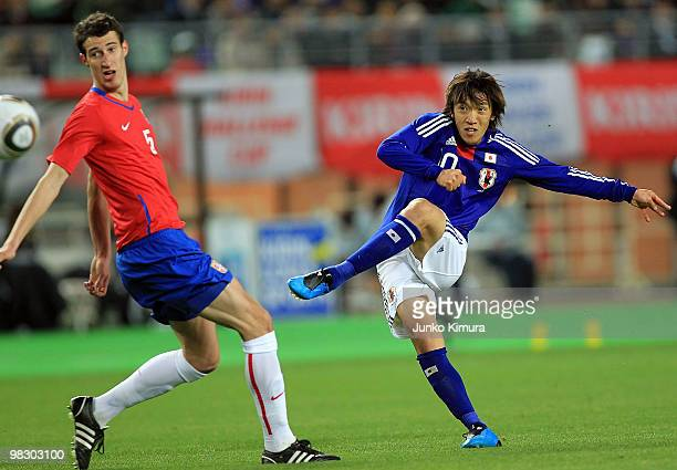 Shunsuke Nakamura of Japan and Radosav Petrovic of Serbia compete for the ball during the Kirin Challenge Cup match between Japan and Serbia at Nagai...
