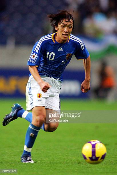 Shunsuke Nakamura of Japan controls the ball during the 2010 FIFA World Cup qualifier match between Japan and Uzbekistan at Saitama Stadium on...