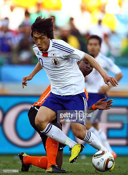 Shunsuke Nakamura of Japan is challenged by Eljero Elia of the Netherlands during the 2010 FIFA World Cup South Africa Group E match between...
