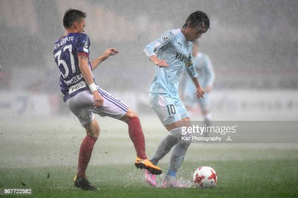 Shunsuke Nakamura of Jubilo Iwata and Ippei Shinozuka of Yokohama FMarinos compete for the ball during the JLeague J1 match between Jubilo Iwata and...