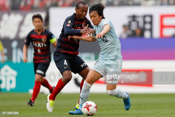 Shunsuke Nakamura of Jubilo Iwata and Leo Silva of Kashima Antlers compete for the ball during the JLeague J1 match between Kashima Antlers and...