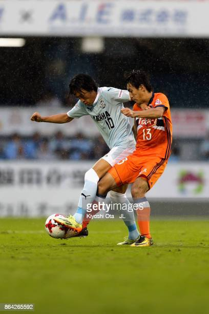 Shunsuke Nakamura of Jubilo Iwata and Masaru Kato of Albirex Niigata compete for the ball during the JLeague J1 match between Jubilo Iwata and...