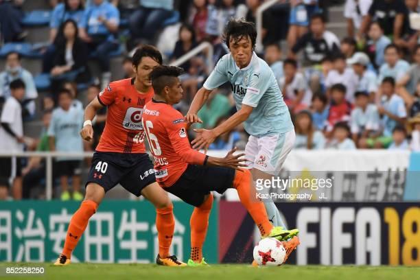 Shunsuke Nakamura of Jubilo Iwata and Mateus of Omiya Ardija compete for the ball during the JLeague J1 match between Jubilo Iwata and Omiya Ardija...