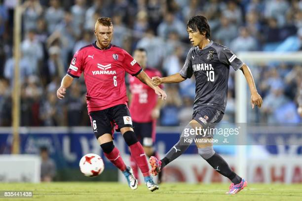 Shunsuke Nakamura of Jubilo Iwata and Souza of Cerezo Osaka compete for the ball during the JLeague J1 match between Jubilo Iwata and Cerezo Osaka at...