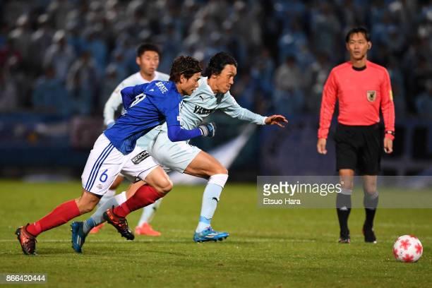 Shunsuke Nakamura of Jubilo Iwata and Takahiro Ogihara of Yokohama FMarinos compete for the ball during the 97th Emperor's Cup quarter final match...