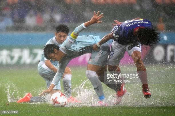 Shunsuke Nakamura of Jubilo Iwata and Yuji Nakazawa of Yokohama FMarinos compete for the ball during the JLeague J1 match between Jubilo Iwata and...