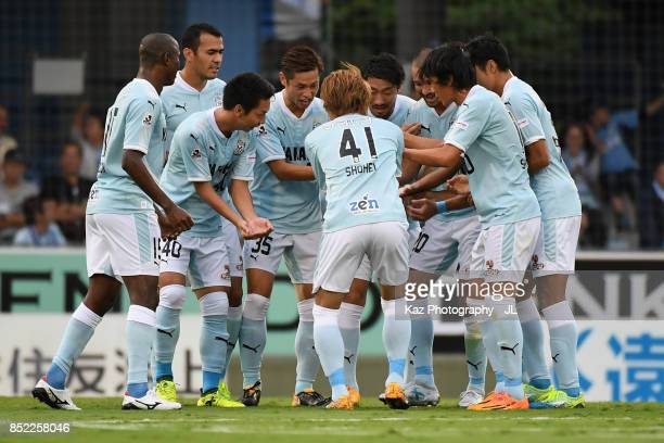 Shunsuke Nakamura of Jubilo Iwata celabrates scoring hsi side's first goal with his team mates during the JLeague J1 match between Jubilo Iwata and...